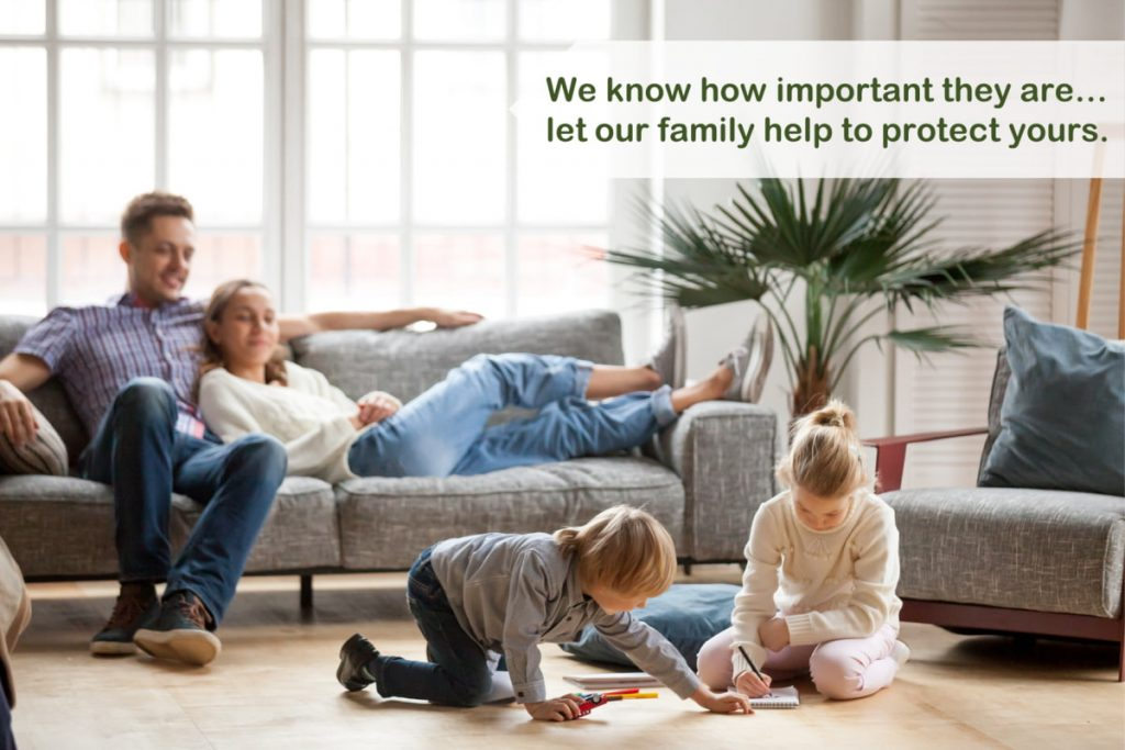Happy family of 4 in lounge room. We know how important they are... let our family help to protect yours